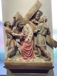 Simon of Cyrene helps Jesus to carry his cross