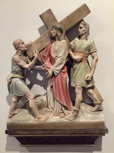 Jesus carries his cross